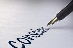 Stock Photo of Fountain pen writing Conscious
