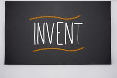 Invent written on big blackboard Stock Illustration
