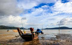 Thai longtail boats at low tide of the sea Stock Photos