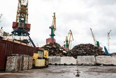 Recycling, loading scrap metal in the ship Stock Photos