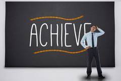 Stock Illustration of Thinking businessman against the word achieve