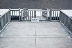gray metal fence to protect the pier - stock photo