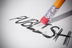 Pencil erasing the word Publish - stock photo