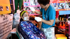 Thailand, Pattaya, February 2014. Woman and beautician during hair removal Stock Footage