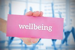 Woman holding pink card saying wellbeing - stock illustration