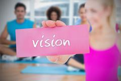 Stock Illustration of Fit blonde holding card saying vision