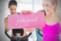 Stock Illustration of Fit blonde holding card saying join now