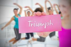 Stock Illustration of Fit blonde holding card saying triumph