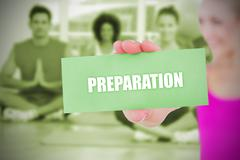Stock Illustration of Fit blonde holding card saying preparation