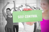 Stock Illustration of Fit blonde holding card saying self control