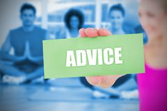 Stock Illustration of Fit blonde holding card saying advice