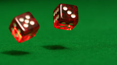 Red dice rolling on casino table - stock footage