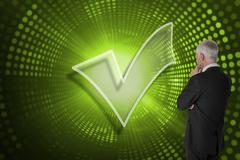 Composite image of tick symbol with businessman looking Stock Illustration