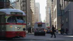 Muni passes through downtown intersection Stock Footage