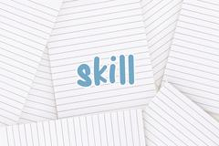 Stock Illustration of Skill against lined paper strewn over surface