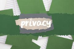 Stock Illustration of Privacy against green paper strewn over notepad