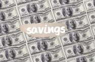 Stock Illustration of Savings against digitally generated sheet of dollar bills