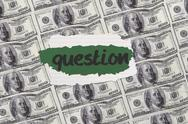 Stock Illustration of Question against digitally generated sheet of dollar bills
