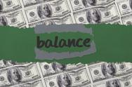Stock Illustration of Balance against digitally generated sheet of dollar bills