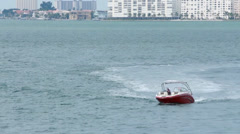 Couple on a red speedboat cruising at low speed Stock Footage