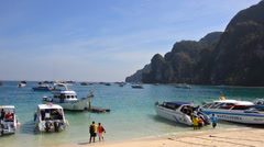 Thailand, Phi Phi Islands, Speedboats at Anchor and Unidentified Tourists. Stock Footage