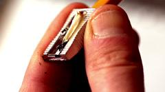 Man paring a pencil close up Stock Footage