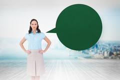 Stock Illustration of Composite image of serious stylish businesswoman posing with speech bubble