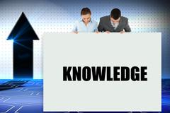 Stock Illustration of Business partners showing card saying knowledge