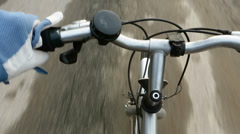 Cyclist riding a bicycle, handlebar detail Stock Footage