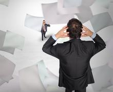 Composite image of stressed businessman with hands on head with tiny businessman - stock illustration