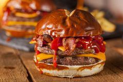 unhealthy homemade barbecue bacon cheeseburger - stock photo