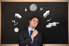 Stock Illustration of Composite image of thinking businessman holding pen