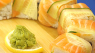 Stock Video Footage of Rotating Sushi with salmon and cucumber