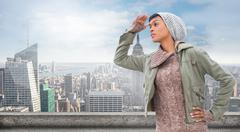 Composite image of concentrated young model in winter clothes watching around Stock Illustration