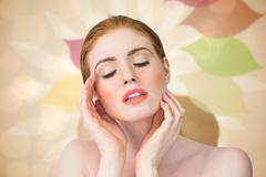 Stock Illustration of Composite image of beautiful redhead posing with hands
