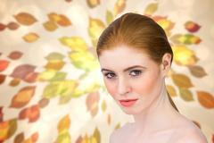 Stock Illustration of Composite image of beautiful redhead looking at camera