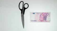 Hands cutting 500 euro note Stock Footage