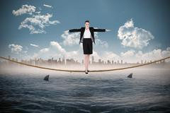 Composite image of businesswoman performing a balancing act - stock illustration