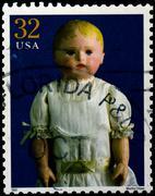 usa - circa 1997 : stamp printed in the usa shows martha chase doll, circa 19 - stock photo