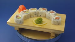 Traditional sushi rolls served on wooden plate. Stock Footage
