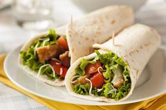 breaded chicken in a tortilla wrap - stock photo