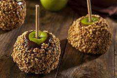 homemade caramel taffy apple with peanuts - stock photo