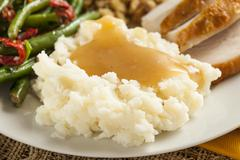 Homemade organic mashed potatoes with gravy Stock Photos