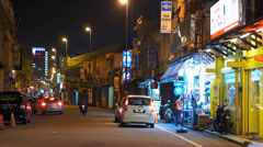 Time Lapse Melaka Malacca Little India street scene Ceremonial Arch Malaysia Stock Footage