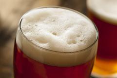 Cool refreshing dark amber beer Stock Photos