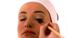 Make up artist putting powder on models face - stock footage