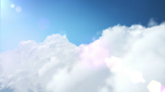Flying through white soft clouds at sunny day. Lens flare. Loopable. Stock Footage