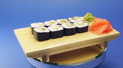 Delicious sushi rolls on wooden plate Stock Footage
