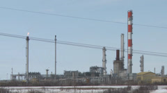 Oil Refinery with flare stack Stock Footage