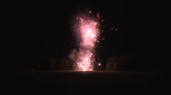 Fireworks blasting off and exploding in the sky Stock Footage